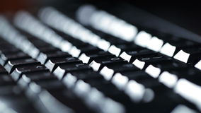 Typing on the keyboard at night. Cool light. Shot on Canon 5D Mark II with Prime L Lenses stock footage