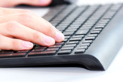 Typing on the keyboard Royalty Free Stock Images