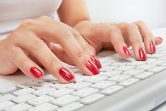 Typing on keyboard Stock Photography