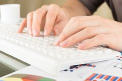 Typing on keyboard. Woman hands, close view royalty free stock images