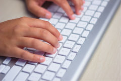 Typing on keyboard. Young Women Fingers Typing on keyboard in close-up stock image