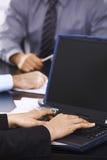 Typing on laptop Stock Photo