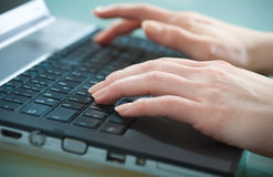 Typing on laptop Stock Image