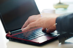 Typing on laptop. Hands typing on laptop in office Royalty Free Stock Photography
