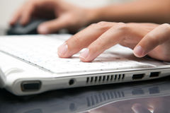 Typing on the laptop Stock Photography