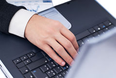 Typing at laptop. Business man typing at laptop, isolated on white Royalty Free Stock Image