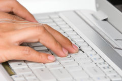 Typing on laptop Stock Photography