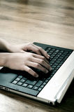 Typing on laptop Stock Photos