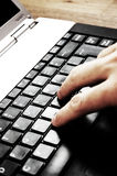Typing on laptop Stock Images