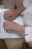 Typing on a laptop Stock Photo