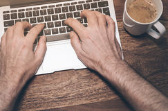 Typing on a laptop computer Stock Photography