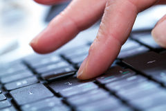 Typing on a laptop royalty free stock image