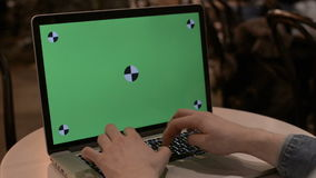 Typing on a laptop with green screen. LAPTOP GREEN-SCREEN DOLLY IN WITH HANDS stock video