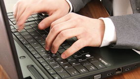 Typing on laptop stock video footage