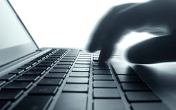 Typing on laptop keyboard. Royalty Free Stock Photography