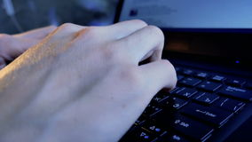 Typing on a laptop Keyboard. Close-up: hands typing on a laptop keyboard stock video footage