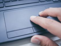 Typing on laptop keyboard stock image