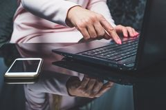 Typing on a laptop keyboard. stock photography