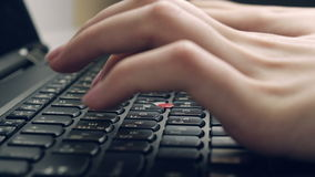 Typing On Laptop Keyboard. Shot From Aside UHD stock footage
