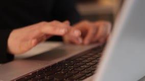 Typing on laptop. Writer typing on modern laptop stock video
