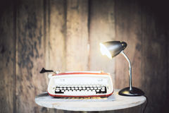 Typing machine and lamp Royalty Free Stock Photo