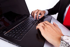 Typing male business man's hands on laptop Royalty Free Stock Images