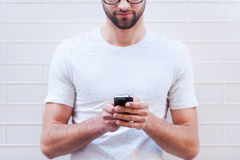 Typing message to friend. Stock Image
