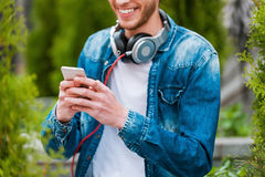 Typing message to friend. Royalty Free Stock Images