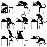 Typing monkeys. Set of editable vector silhouettes of monkeys and typewriters with all figures as separate objects Stock Photo