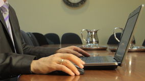 Typing on a Notebook in the office. Businessman moving a computer mouse and typing on the keyboard of a Notebook stock video