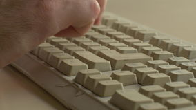 Typing on old beat up keyboard stock video footage