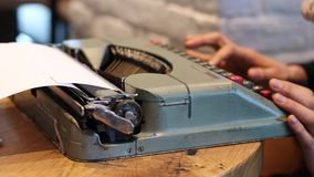 Typing on old fashion typing machine stock video footage