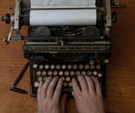 Typing on an old typewriter. Man typing on an old typewriter, with a retro effect. Copy space included Royalty Free Stock Photography