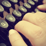 Typing on an old typewriter, with a retro effect Stock Photos