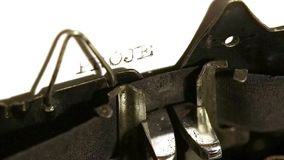 Typing with old typewriting machine. Word projects stock footage