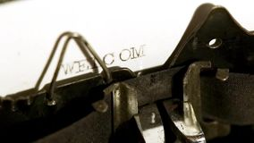 Typing with old typewriting machine stock video footage