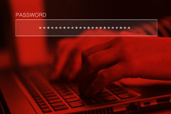 Typing online account password on laptop computer keyboard Royalty Free Stock Photos