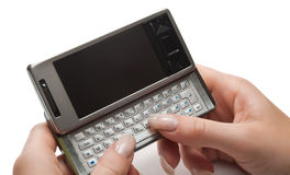 Typing on pda. (personal digital assistant), isolated Royalty Free Stock Image