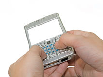 Typing on pda with empty copy-space on the screen Royalty Free Stock Images
