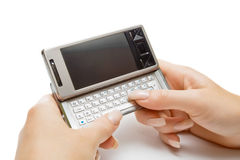 Typing on pda, isolated Royalty Free Stock Photos