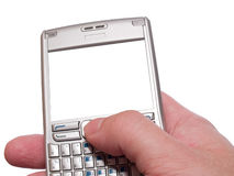 Typing on personal digital assistant. Smartphone with empty frame isolated on white stock photography