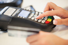 Typing the Pin Code into the Card Reader Stock Image