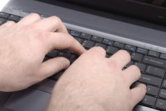 Typing In Progress. Male hands typing over black keyboard Royalty Free Stock Photo