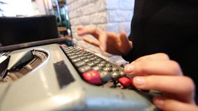 Typing slow on old fashion typing machine side view stock video footage