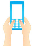 Typing a SMS. On a cell phone Royalty Free Stock Images