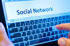 Typing social network Stock Photo