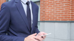 Typing Text Message on Phone, Close Up of Walking Young Businessman. Creative designer , businessman stock video