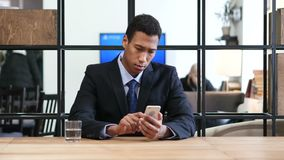 Typing Text Message on Smartphone. Young creative designer , good looking stock footage
