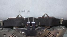 Typing text at the typewrite. Typing Call Me at the typewriter stock video footage