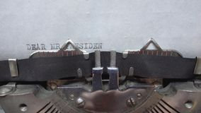 Typing text at the typewrite. Typing Dear Mr President at the typewriter stock video